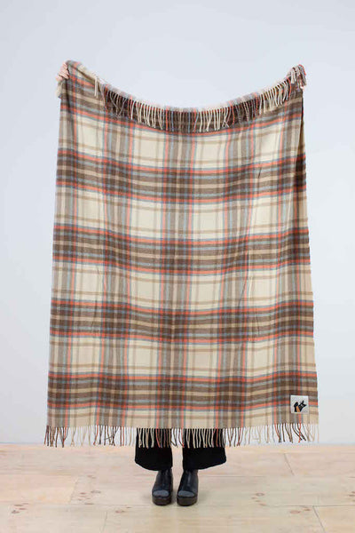 Woolen throw in brown, cream and grey check
