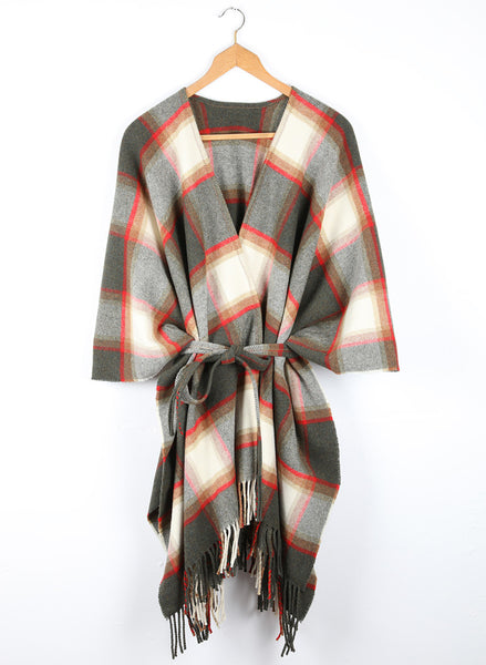 A wool cape featuring a country block check of forest green and brackens with ecru and a highlight of vermillion.