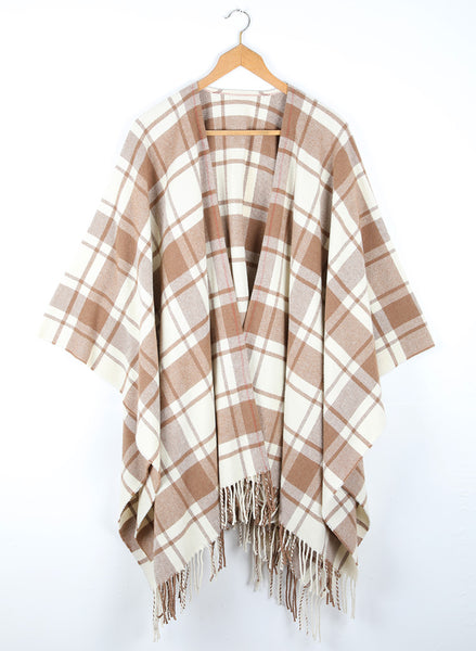 A wool cape with a simple check of natural white and caramel.