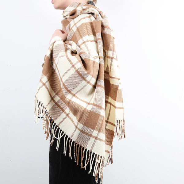 A wool shawl/stole with a simple check of natural white and caramel.