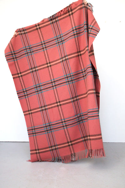 Checked blanket in pink, dark green, blue, grey and yellow
