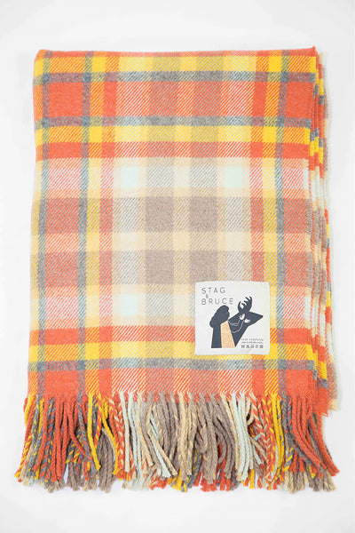 Wool throw with a bold check of gold and natural tones inspired by the Scottish landscape