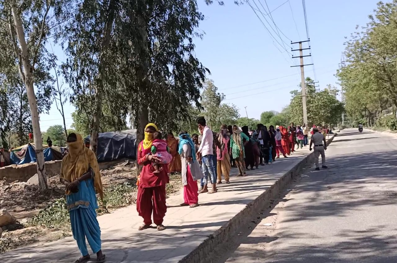 Line of people to receive food during COVID-19 Pandemic, New Delhi, India
