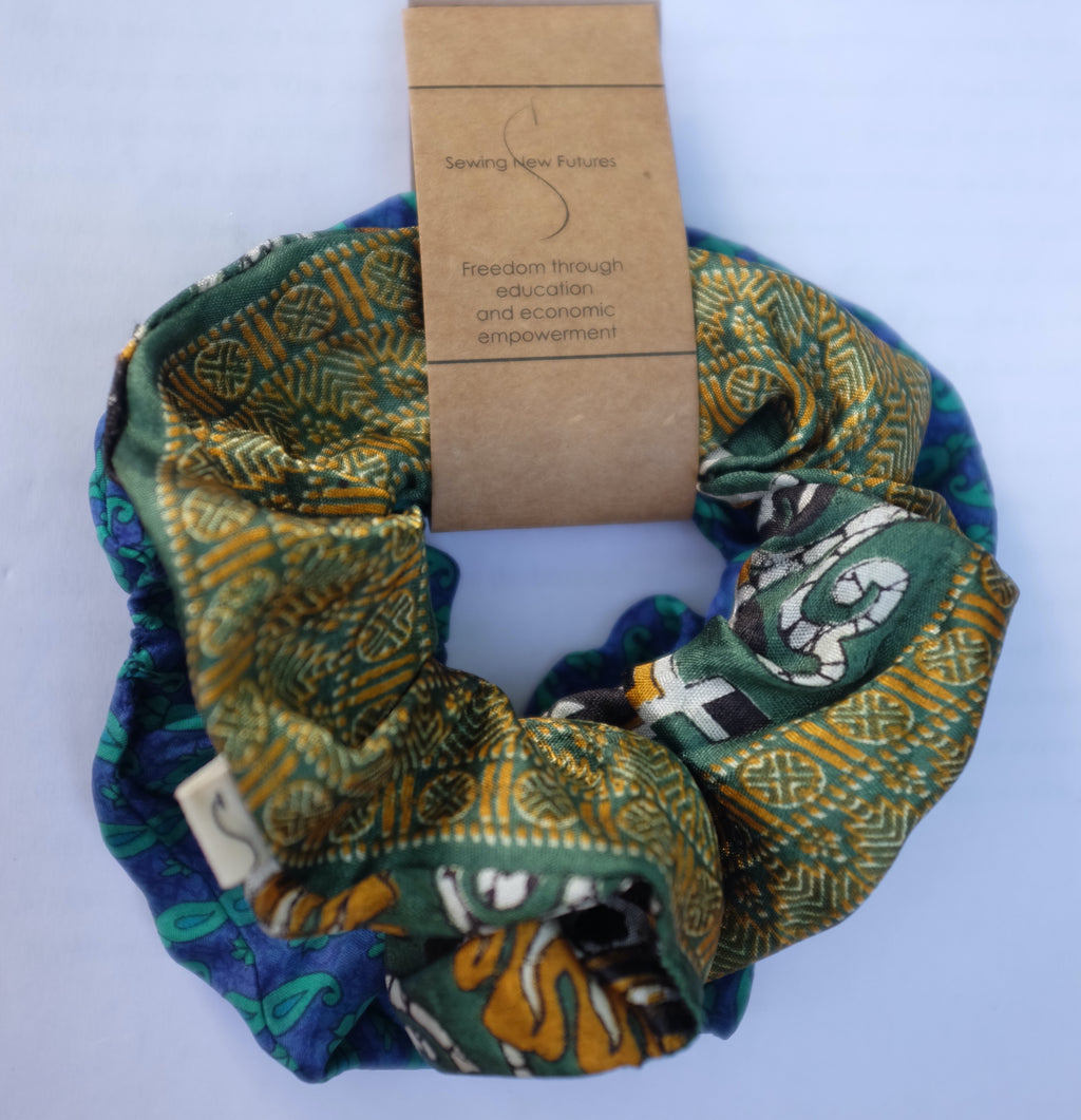 green scrunchie sewn from vintage sari fabric