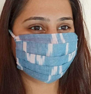 cotton pale blue ikat print  face mask handsewn in India by the NGO Sewing New Futures.