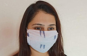 cotton white & blue ikat print double layer face mask handsewn in India by the NGO Sewing New Futures.