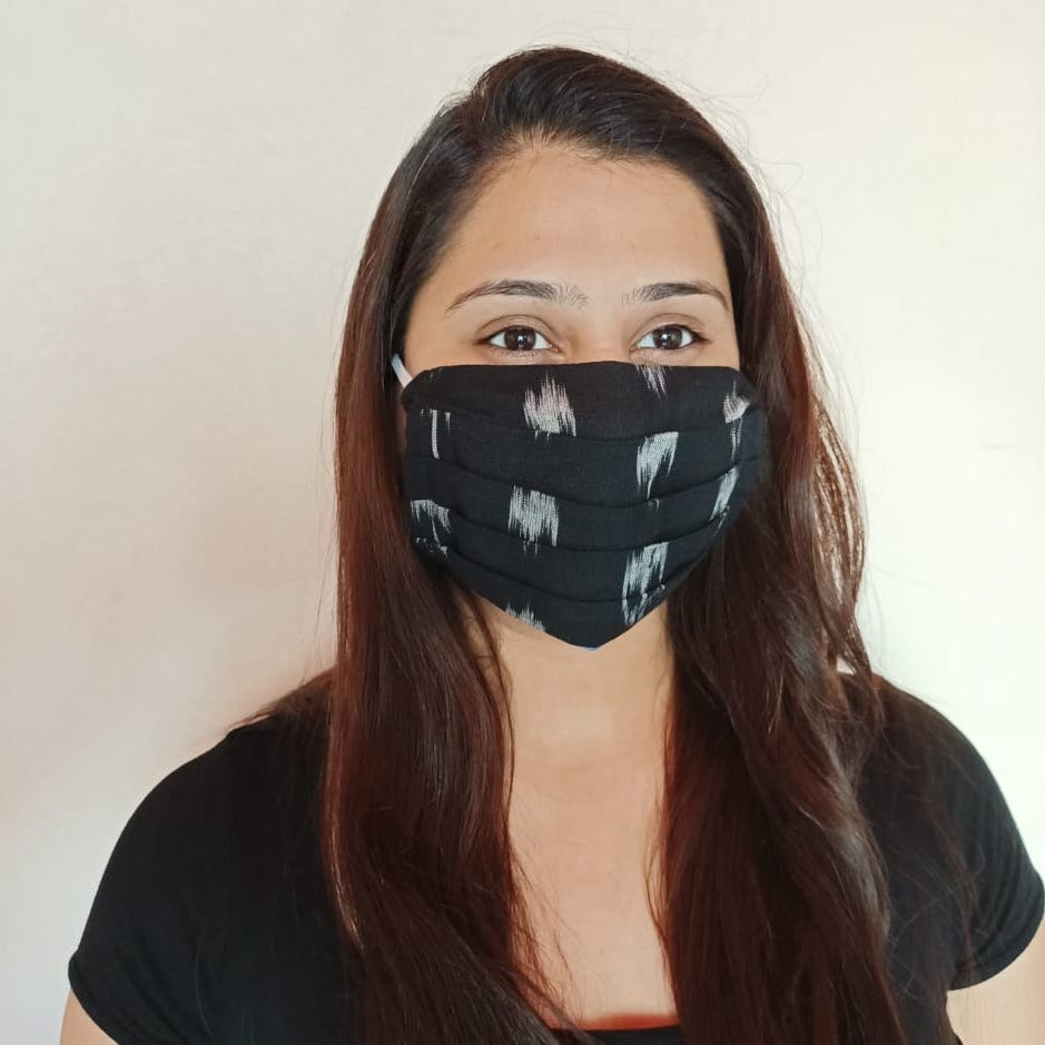 black cotton ikat double layer facemask hand sewn in India by artisans at the CHARITABLE NGO Sewing New Futures.