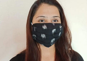 black cotton ikat double layer facemask hand sewn in India by artisans at Sewing New Futures.