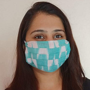 cotton sea green  ikat print  face mask handsewn in India by the NGO Sewing New Futures.