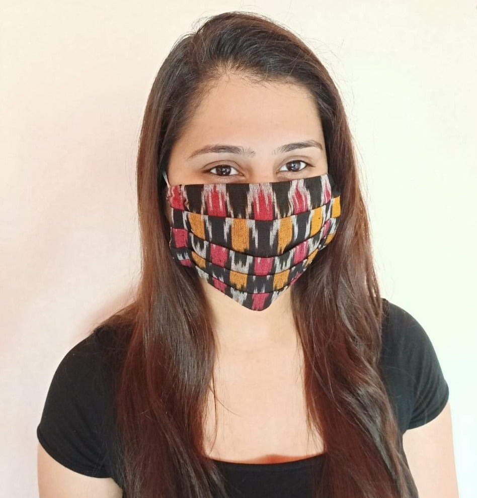 cotton black teen color ikat print  face mask handsewn in India by the NGO Sewing New Futures.