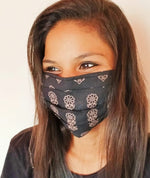 woman wearing black cotton face mask with elastic earloops