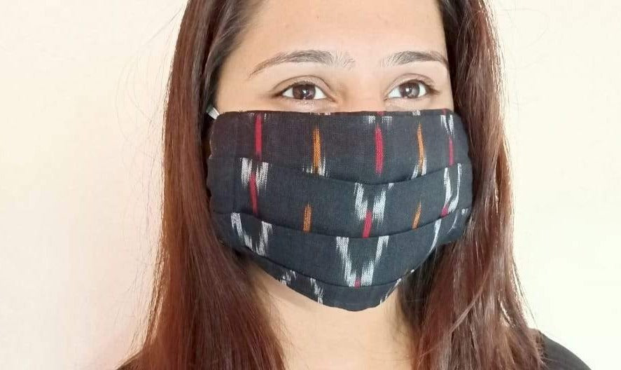 Black ikat print  face mask handsewn in India by the NGO Sewing New Futures.