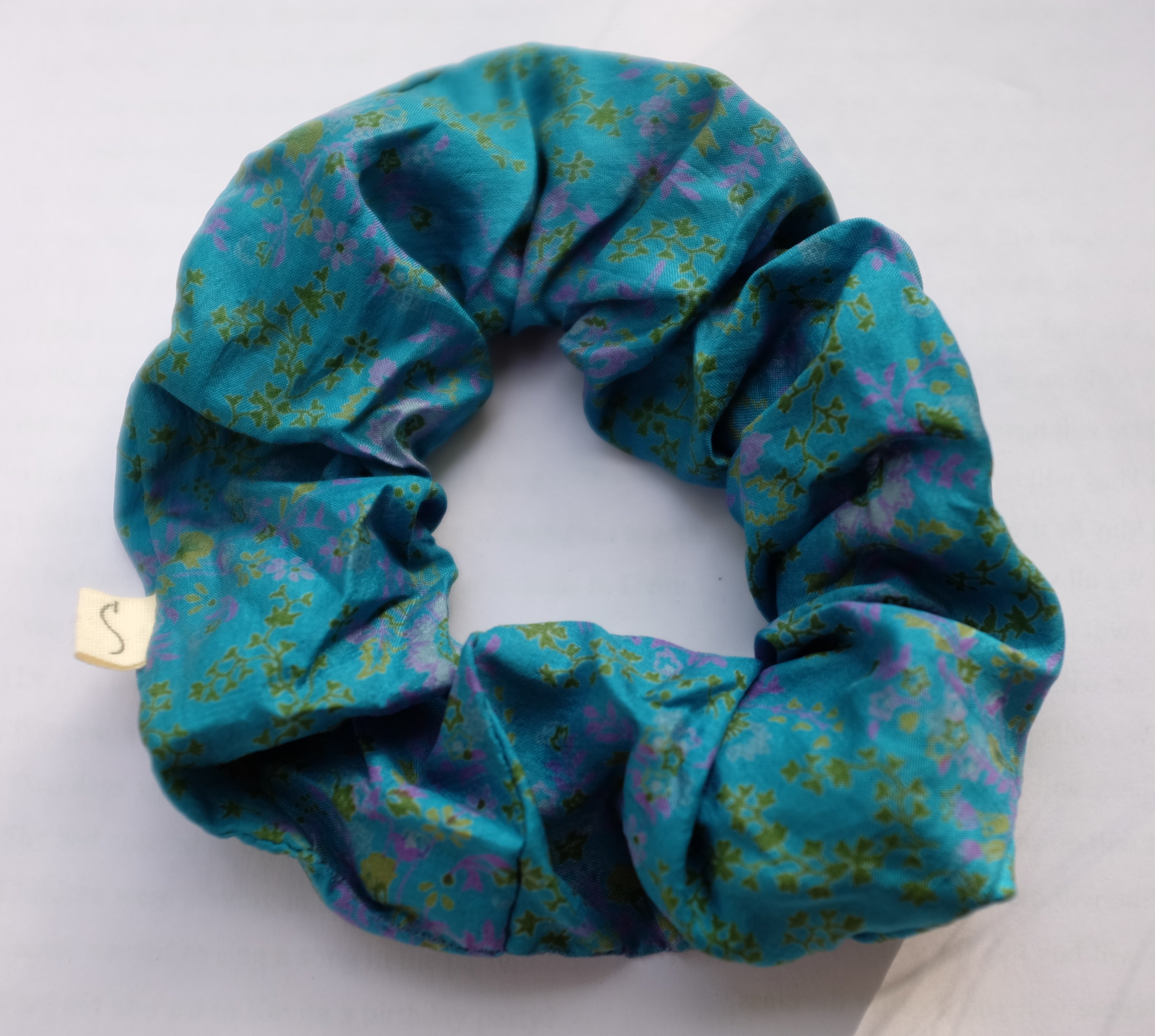 blue scrunchie made from recycled sari fabric