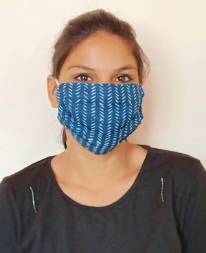 woman wearing blue cotton face mask with elastic earloops