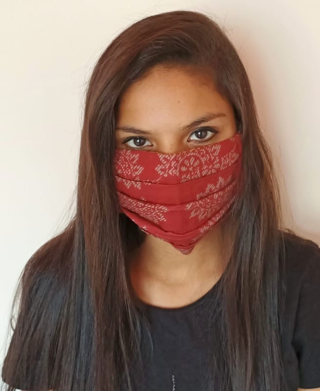 woman wearing  red cotton face mask with elastic earloops