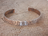 rustic bronze cuff with sun moon and stars