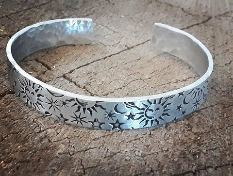 silver colored sun moon and stars cuff bracelet