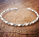 dainty silver twisted wire cuff made from pattern wire