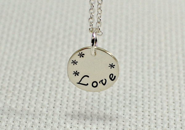 "Sterling silver charm necklace handstamped with ""Love"""