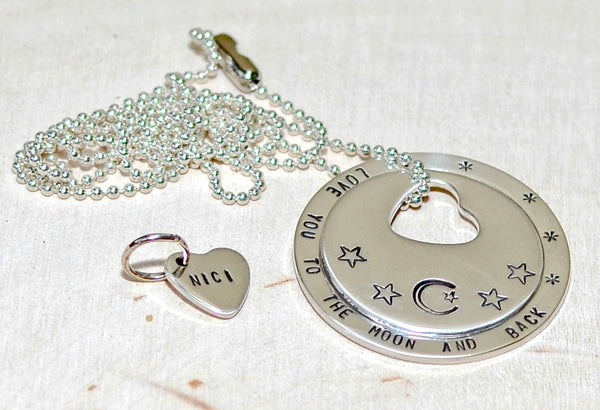 Disc washer necklace in sterling silver with heart charm and love you to the moon and back