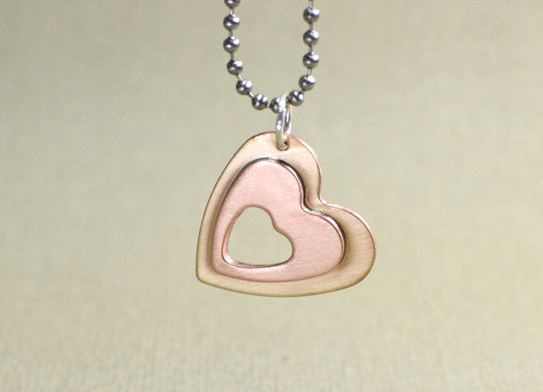 Heart charm pendant with a love window in copper and bronze