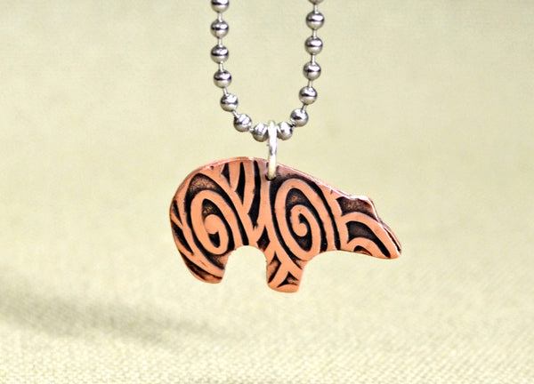 Copper spirit bear necklace with swirling hammered texture