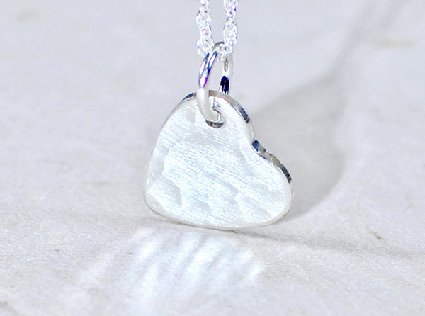 Hammered dainty sterling silver heart charm elegantly hammered with love