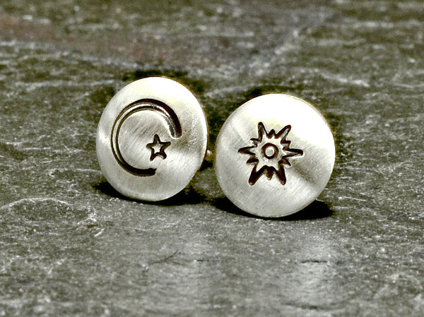 Stud earrings featuring sun moon and star in sterling silver