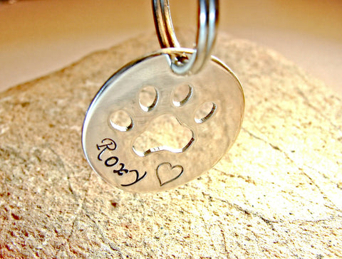 Sterling silver dog tag with personalized paw cut out, NiciArt