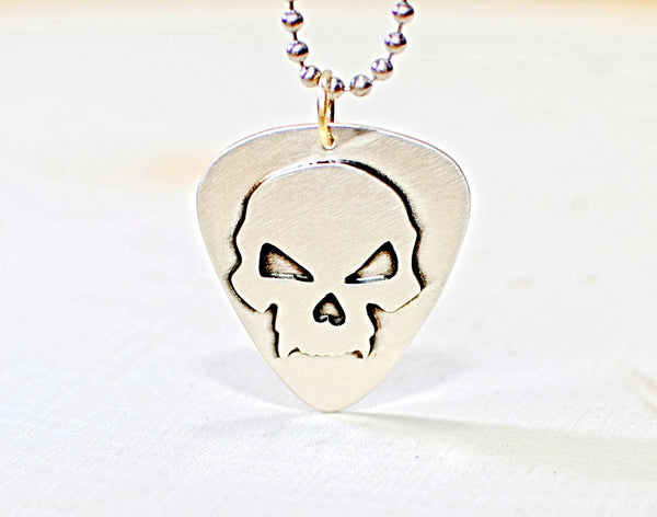 Sterling silver guitar pick with skull