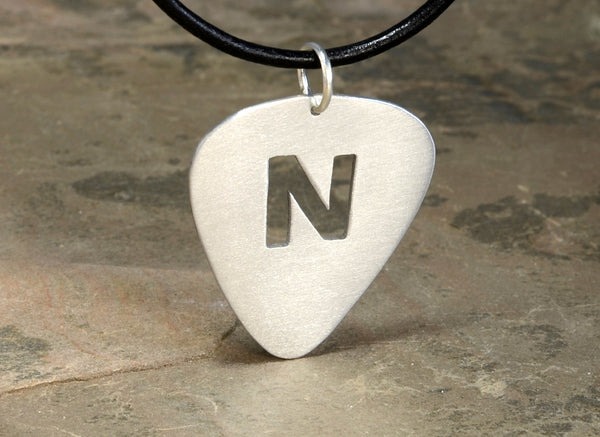 Guitar pick necklace with personalized initial cut out