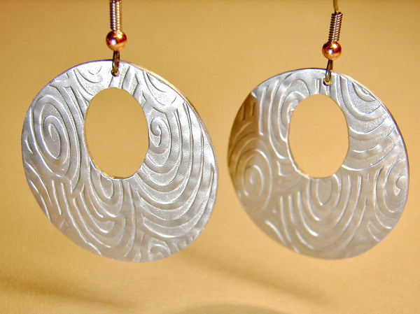 Silver spiral disc earrings handmade in aluminum