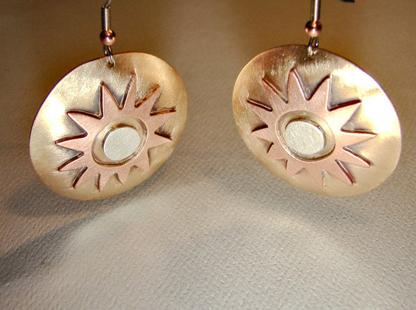 Earrings with desert sun in a harmonious fusion of bronze copper and sterling silver
