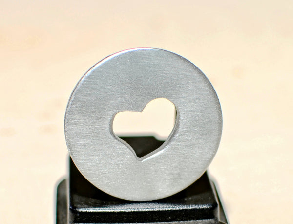 Golf marker with heart cut out