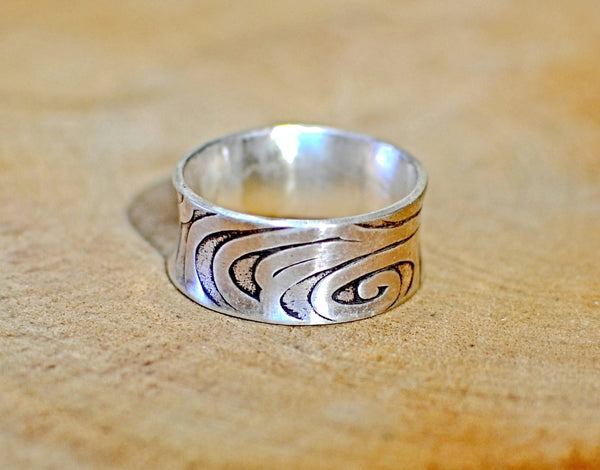 Sterling silver anticlastic ring handmade with swirling pattern