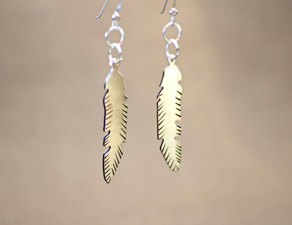 Sterling silver tribal feather dangle earrings