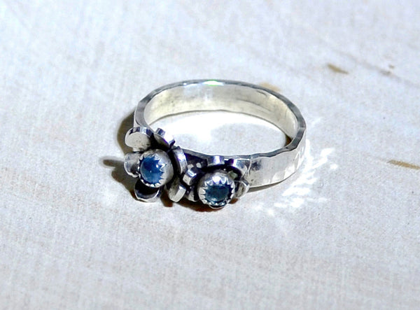 Sterling Silver Ring with Flowers and Blue Topaz