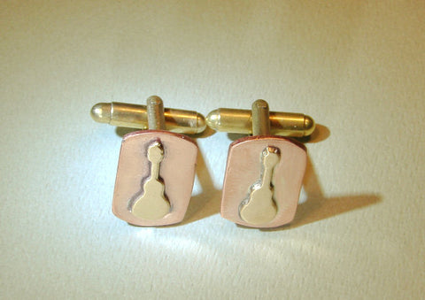 Bronze guitar cuff links rocking out on copper, NiciArt