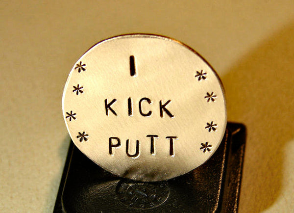 Bronze golf marker in bronze stamped with I kick putt, NiciArt