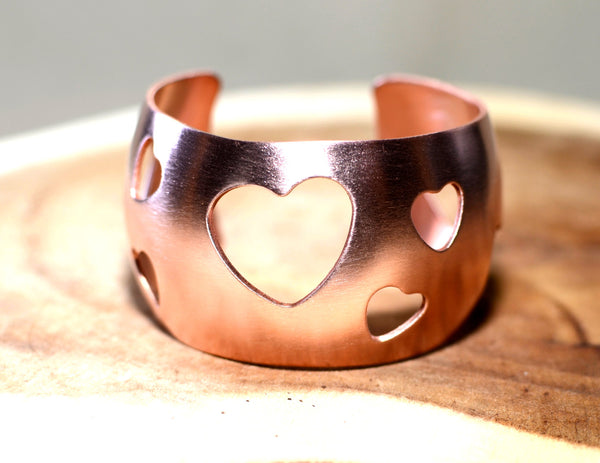 Copper synclastic cuff bracelet with cut out hearts