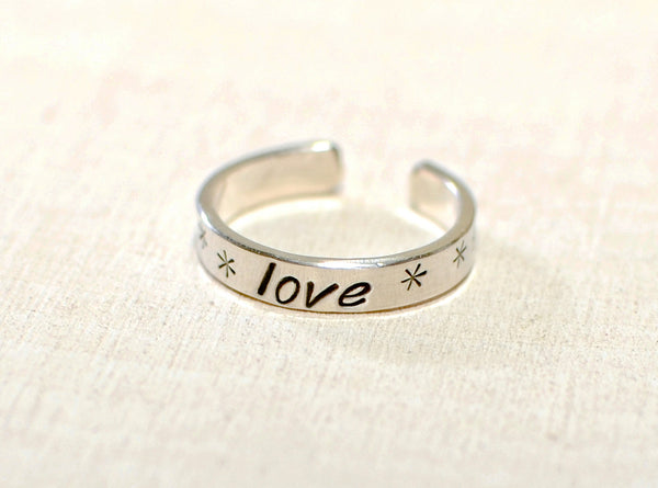 Sterling silver toe ring with lots of love