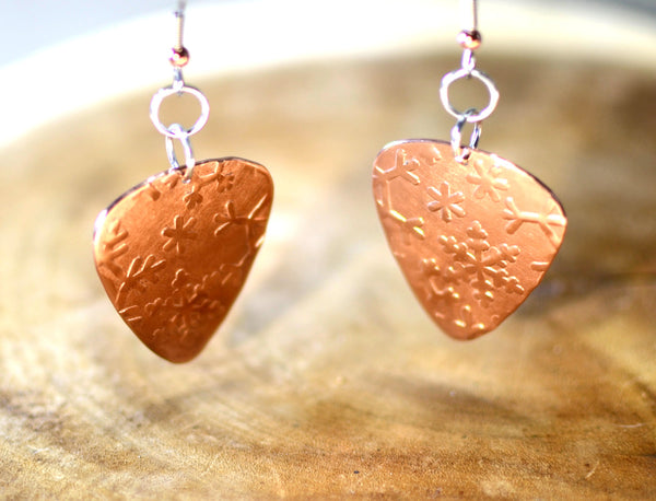 Hammered copper guitar pick earrings with snowflakes
