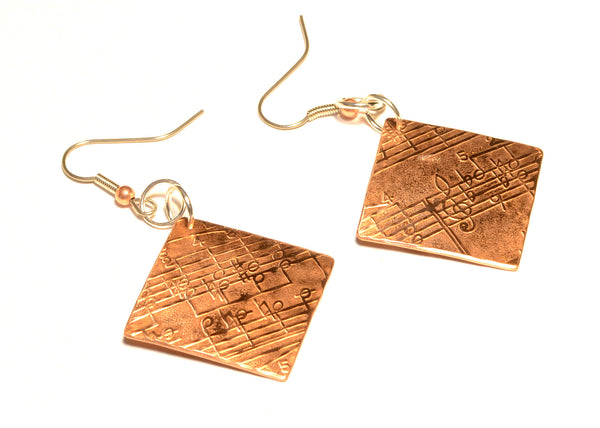 Musically Inspired Copper Dangle Earrings with Metallic Melody