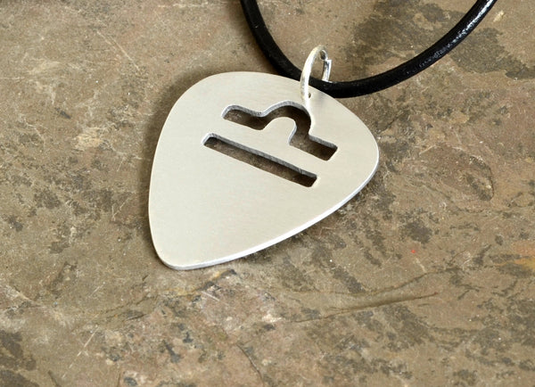 Personalized aluminum guitar pick necklace with zodiac sign