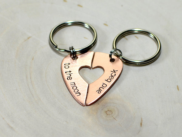 Couples guitar pick keychain with heart cut out and messages of love