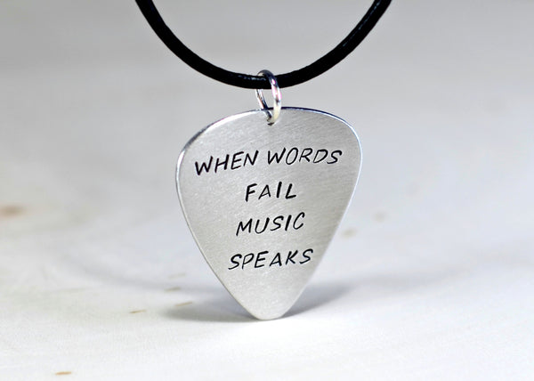 Guitar pick necklace when words fail music speaks