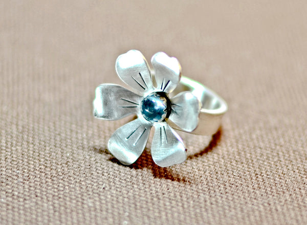 Radiant blooming sterling silver flower ring with blue topaz