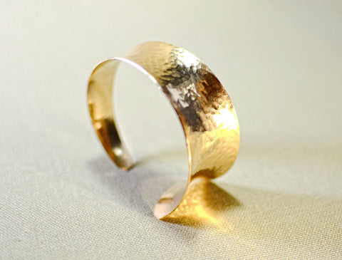 Hammered bronze cuff bracelet with anticlastic form and tapered curve, NiciArt