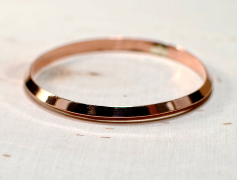 Triangular bangle handcrafted in copper