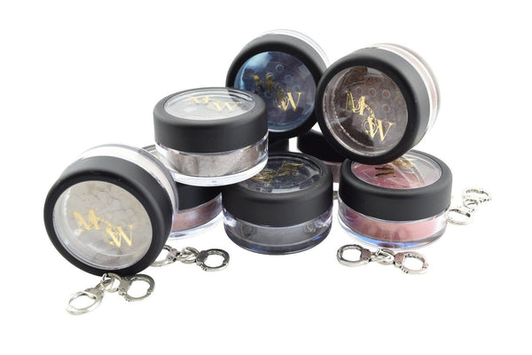 multiple jars of glitter eyeshadow for men